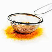 Yellow curry powder in strainer