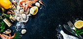 Delicious fresh fish and seafood on dark vintage background