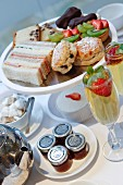 Afternoon tea, champagne, english tea, fruit tartlets, fruit tarts, restaurant, sandwiches, scones