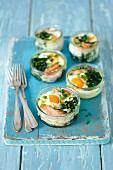 Fried eggs with spinach and salmon