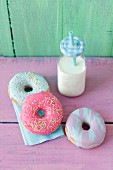 Doughnuts with a colorful sugar glaze and a milk bottle