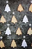 Christmas tree shaped cookies on dark background