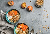 Healthy vegetarian breakfast: Oatmeal, quinoa granola with yogurt, dried fruit, seeds, honey, fresh persimmon in bowls