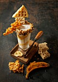 Banana and vanilla milkshake with caramel cream and crunchy decorations
