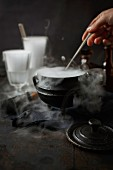 A steaming iron pot