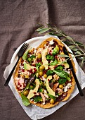 Chickpea pizza with trout fillets, avocado, pomegranate and feta
