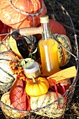 Pumpkin products in a basket with pumpkins