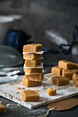 Homemade vanilla fudge cubes on wooden boards
