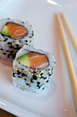 Maki Sushi with salmon, avocado and sesame