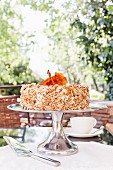 Carrot and banana cake with vanilla buttercream and pecans
