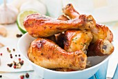 Delicious roasted chicken legs in a bowl