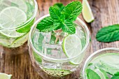 Ice cold cocktail with lime and mint