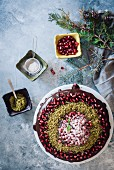 Christmas chocolate cake decorated with pomegranate seeds and pistachio