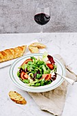 Fresh green salad with baguette and wine