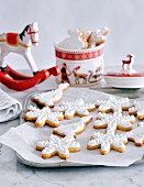 Decorated Christmas cookies on metal sheet and cookie jar