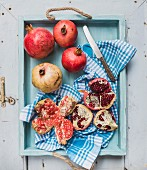 Pomegranate on a wooden tray