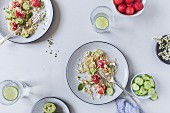 Two half eaten plates with watermelon bulgur salad