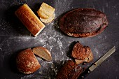 Various types of bread, some sliced