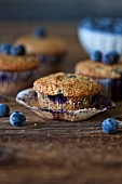 Freshly baked Blueberry hazelnut muffins on a rustic wooden table