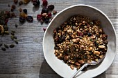 Bowl of Homemade Granola with Nuts, Seeds, Raisins and Cranberries