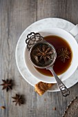 Tea with Tea Strainer in a Cup and Saucer