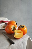 Still life with persimmon on a table