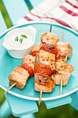Grilled salmon kebabs with cherry tomatoes and garlic sauce