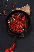 Dried Red Chillies in a cast iron skillet