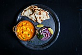 Paneer Butter Masala served with Nan and salad