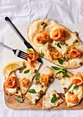 Naan pizzas with buffalo mozzarella, smoked trout and capers