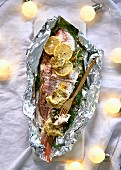 Fish with fennel and caper butter served in aluminium foil