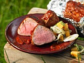Grilled pork fillets marinated with chilli and orange