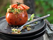 Grilled tomatoes, stuffed with couscous