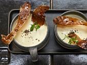 Parsnip and potato soup with crispy fried Parma ham
