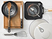 Kitchen utensils: pan, grill pan, salad bowl, spatula, a measuring cup