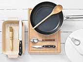 Various kitchen utensils: pan, salad bowl, casserole dish