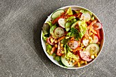 Mixed salad with radishes, carrot, sweetcorn, tomato and cucumber