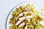 Roast turkey strips on a bed of sweetcorn and avocado salad with salsa