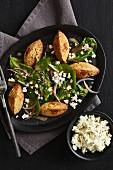 Spinach salad with cauliflower falafel and feta