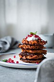 Harissa sweet potato latkes with spiced yogurt, mint and pomegranate, gluten-free