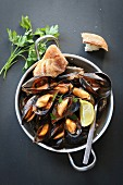 Cooked mussels in tomato sauce garnished with parsley