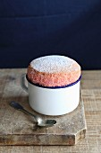 Strawberry souffle in enamel mug