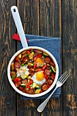 Fried sausage with vegetables and egg