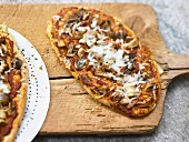 Pizza with mushrooms and goat's gouda