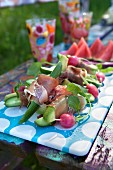 Salad and tapas on colourful park bench, summertime
