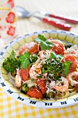 Pasta with shrimps, oven-baked cherry tomatoes, broccoli, fresh coriander and grated parmesan