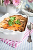 Pie with cheese, pumpkin seeds, smoked pepper and leaf parsley