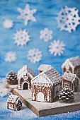 Gingerbread houses decorated with white royal icing