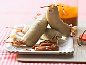 Zander-Weisswürstchen mit Curry-Orangen-Ketchup