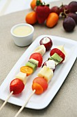 Fruit skewers with white chocolate cream